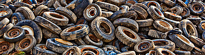 Pile of tires in junkyard - p555m1454202 by Chris Clor
