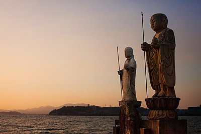 Sculptures by Lake Shinji against clear sky during sunset - p1166m1141480 by Cavan Images