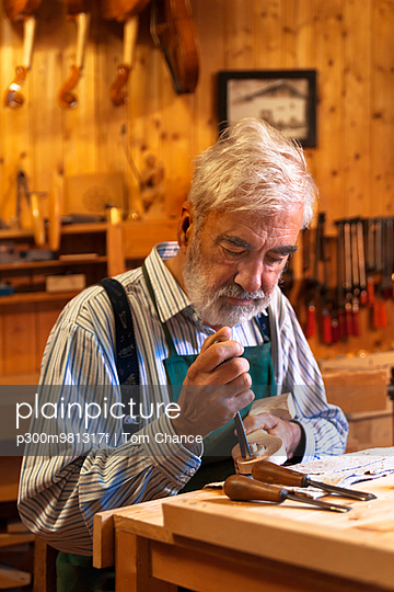 Violin maker at work - p300m981317f by Tom Chance