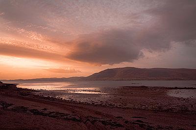 Sunrise at the seaside near Carlingford, Ireland - p1681m2283631 by Juan Alfonso Solis