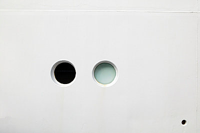 Two portholes of cruise ship - p388m701861 by L.B.Jeffries