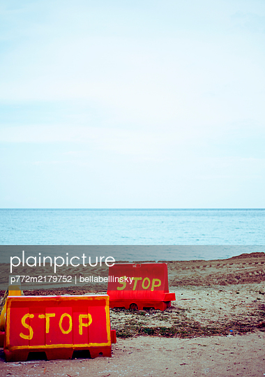 Red stop signs on the beach, Greece - p772m2179752 by bellabellinsky
