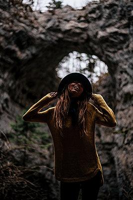 Happy woman in the Rakov Skocjan cave system in Slovenia - p1455m2081768 by Ingmar Wein