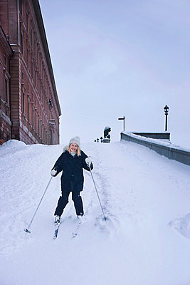 A skier at the castle in Stockholm. - p312m672776 by Bruno Ehrs