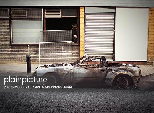 Burnt out car after London Riot - p1072m836371 by Neville Mountford-Hoare