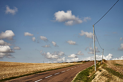 Rural road with blue sky and clouds - p1312m2279022 by Axel Killian