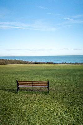 Wooden bench with ocean view - p795m2002023 by JanJasperKlein