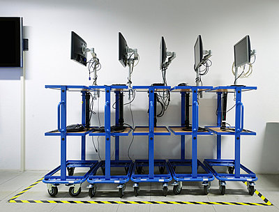 Computers on rolling carts - p429m665275f by Mischa Keijser
