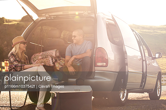 Young people camping by car