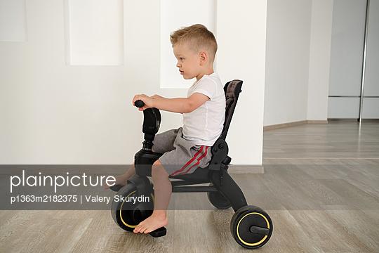 Boy on a bicycle - p1363m2182375 by Valery Skurydin