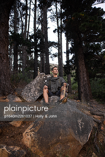 Hiker takes a break on a boulder - p1640m2261037 by Holly & John