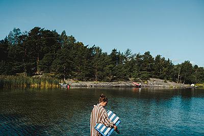 Woman at sea - p312m2146182 by Stina Gränfors