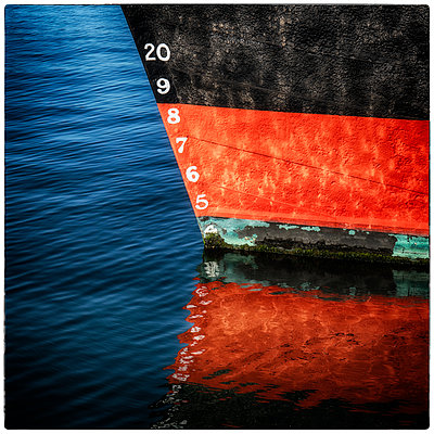 Reflection of ship's bow on water surface - p1154m1110149 by Tom Hogan