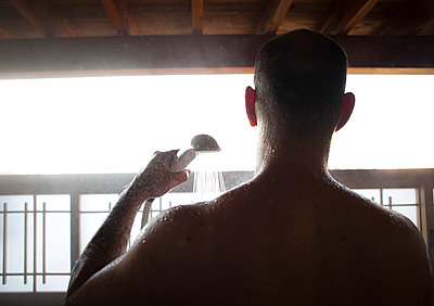 Back View of Man Taking Shower Outdoors - p669m806451 by Kelly Davidson