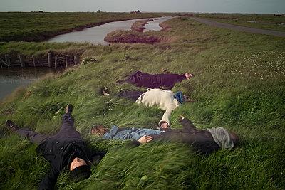 Lying on meadow - p1631m2217692 by Raphaël Lorand