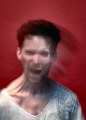 Screaming man, blurred motion - p1652m2230740 by Callum Ollason