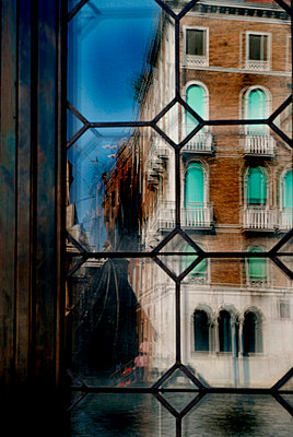 Distorted view of an old Venetian building through glass - p3314011 by Thomas Ortolan