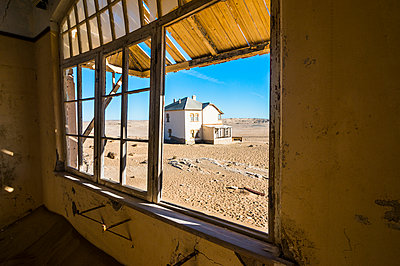 Window of an old colonial house, old diamond ghost town, Kolmanskop (Coleman's Hill), near Luderitz, Namibia, Africa - p871m1478781 by Michael Runkel