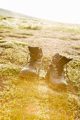 Boots in grass - p312m1548536 by Johner