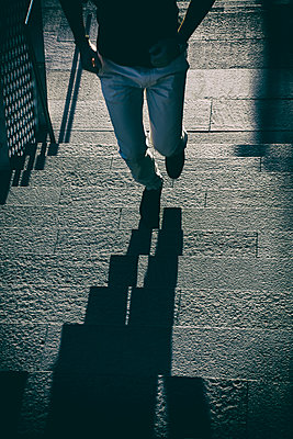 Close up of a man climbing the stairs in a hurry  - p794m1492960 by Mohamad Itani