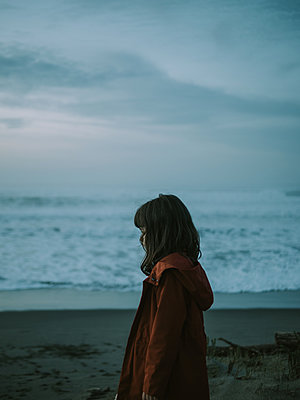 Little girl on the beach at twilight - p1522m2273347 by Almag
