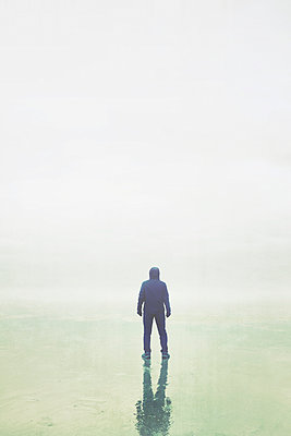 Hooded man in the fog - p597m1425606 by Tim Robinson