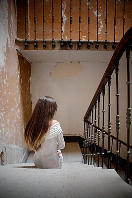 Woman in the stairwell of a castle - p1105m2245469 by Virginie Plauchut