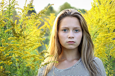 Girl with Goldenrod in Fall  - p1019m1480938 by Stephen Carroll