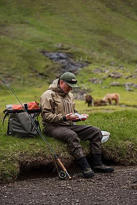 Angler resting - p312m2139297 by Hans Berggren