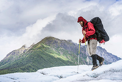 Male hiker on Root Glacier Wrangell St. Elias National Park and Preserve near McCarthy, Alaska - p343m1475634 by Cavan Images