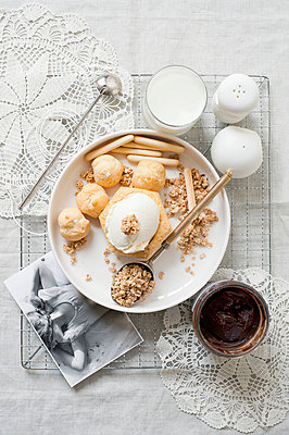 Plate of cream puffs with oatmeal - p429m743867 by Magdalena Niemczyk - ElanArt