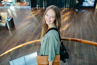 Smiling young woman - p312m1210914 by Anna Rostrom