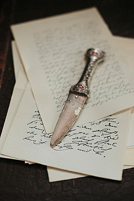 Dagger on old letters - p946m951098 by Maren Becker