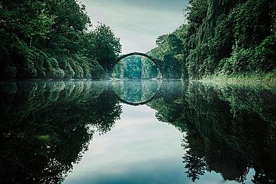 Tranquil Rakotzbruecke Devils Bridge, Rakotzbruecke, Brandenburg, Germany - p301m2075646 by Sven Hagolani
