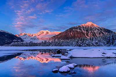 Winter afternoon sunset along the shoreline of Mendenhall River, Tongass National Forest; Alaska, United States of America - p442m2074250 by John Hyde