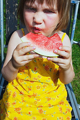 Girl Eating Lemonade Watermelon  - p847m1529266 by Mikael Andersson