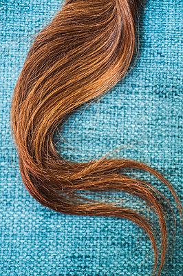 Strand of hair - p971m1060865 by Reilika Landen