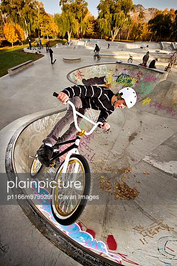 BMX Rider In Skate Park Bowl