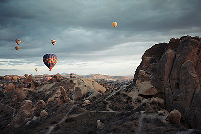 Air balloons flying over the rocks of Cappadocia - p1577m2175348 by zhenikeyev