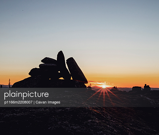 Cairn in silhouette at sunset, Baldpate Mountain Appalachian Trail - p1166m2208007 by Cavan Images