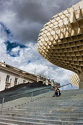 Man waiting on Metropol Parasol steps - p1445m2150461 by Eugenia Kyriakopoulou