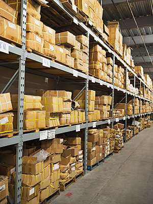 Shelves of boxes in textile factory - p555m1453327 by Erik Isakson