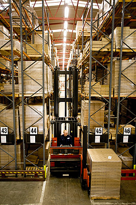 Forklift moving pallets in warehouse - p62320012f by James Hardy
