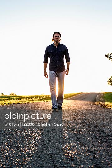 Man Walking Tall  - p1019m1122360 by Stephen Carroll