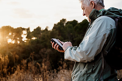 Barcelona, Spain. Mature man in countryside during sunset. Hike, active senior, activity, freedom, active people, exercise, healthy, healthy, retired, jubilee, pentionist, sunset, winter - p300m2250116 von VITTA GALLERY