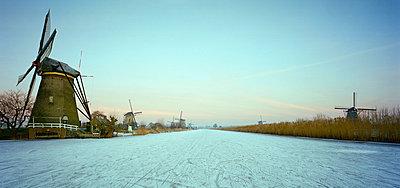 Frozen river in rural landscape - p42919034f by Mischa Keijser