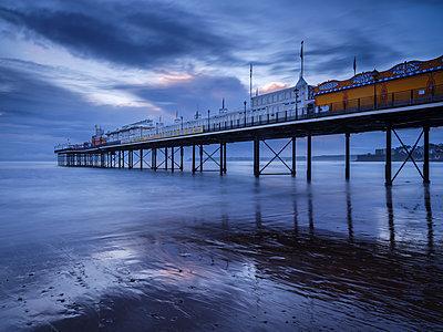 The photogenic Pier in dawn twilight at Paignton, Devon England, United Kingdom - p871m2113732 by Baxter Bradford