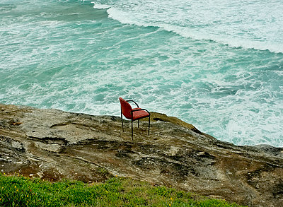 Armchair on ocean cliff  - p1125m2013967 by jonlove