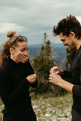 that moment when he proposes on a mountain top and she's overwhelmed - p1166m2192100 by Cavan Images