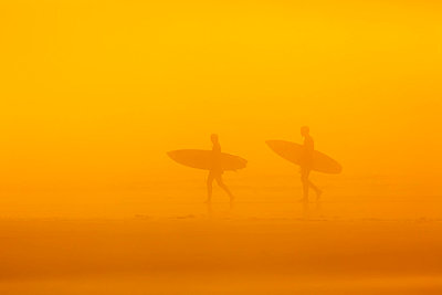 Surfers in the fog on long beach pacific rim national park;Vancouver island british columbia canada - p442m837635f by Ken Gillespie